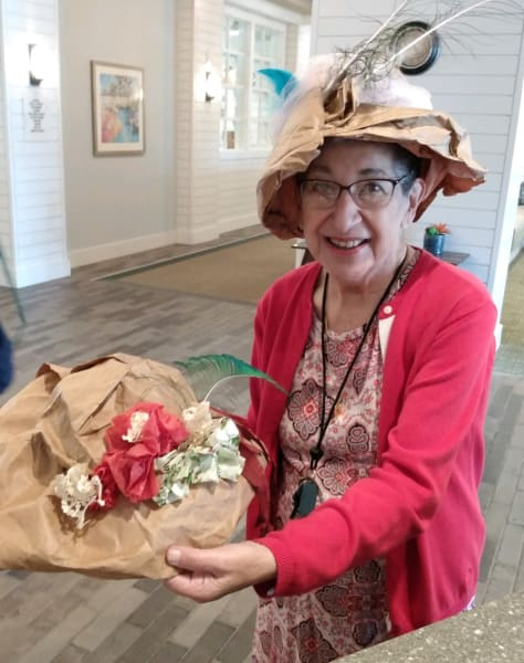 A Carolina Park resident decorates her paper bag hat with gorgeous flowers.
