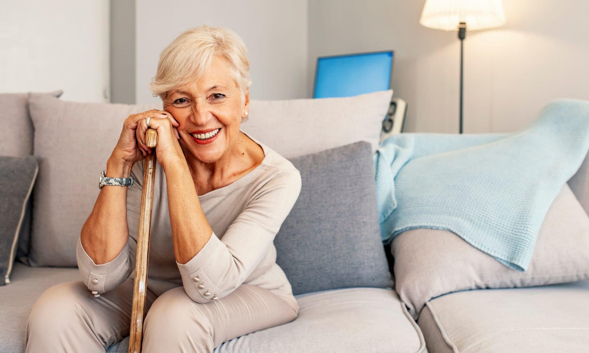 Woman sitting on a couch at Broadwell Senior Living in Kearney, Nebraska