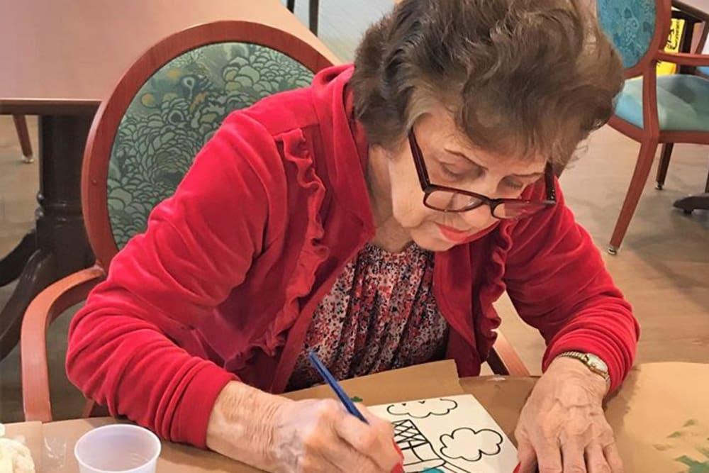senior woman drawing