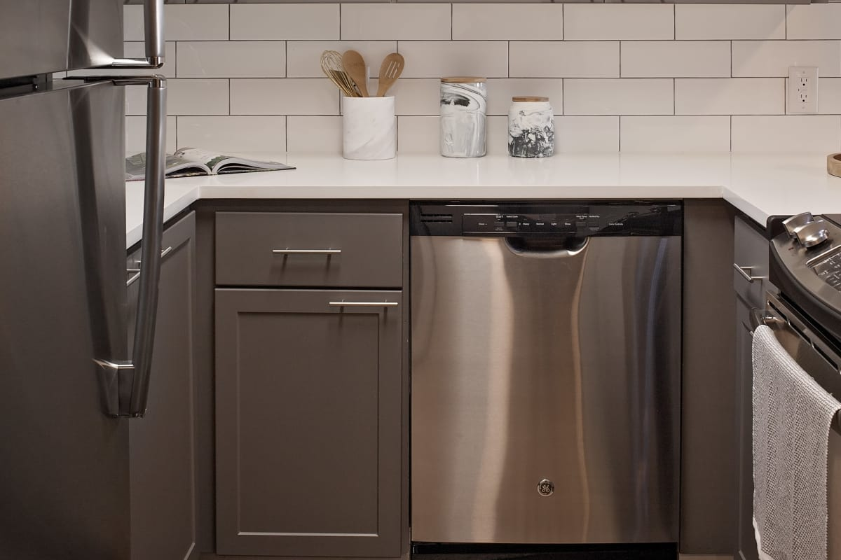Stainless-steel appliances and subway tile backsplash in model kitchen at MiLO at Mountain Park