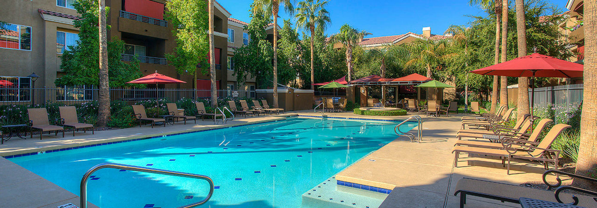 Beautiful resort-style pool with patio seating at Park on Bell in Phoenix, Arizona
