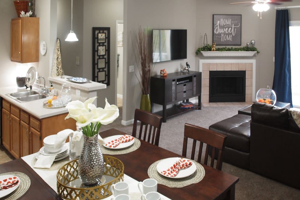 dining and living room with fireplace at Waterford Place in Loveland, Ohio