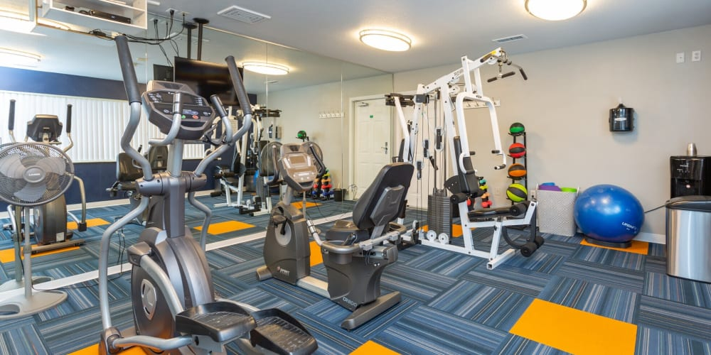 Fitness center with individual workout stations at Stone Crest in Mt Pleasant, Michigan