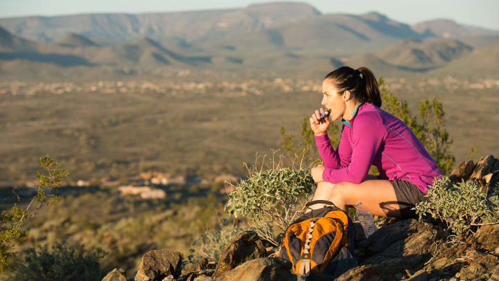 Resident taking a break from her hike to enjoy the view near Olympus Steelyard in Chandler, Arizona