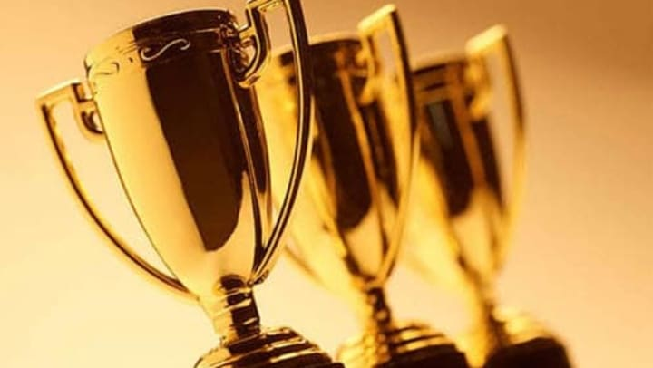Trophies for poster contest at {{location_name}} in {{location_city}}, {{location_state_name}}