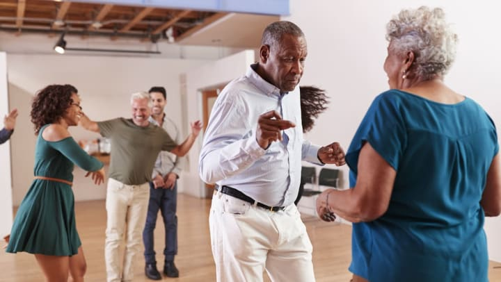 Senior couple dancing in a dance class