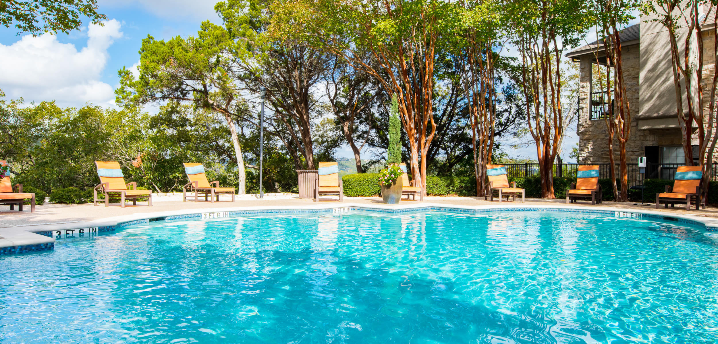 Sparkling pool at Marquis at Treetops in Austin Texas,