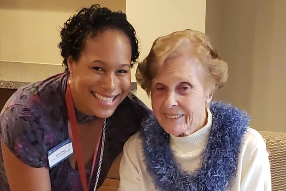 Activity Director and resident smiling together at Merrill Gardens at Rancho Cucamonga in Rancho Cucamonga, California