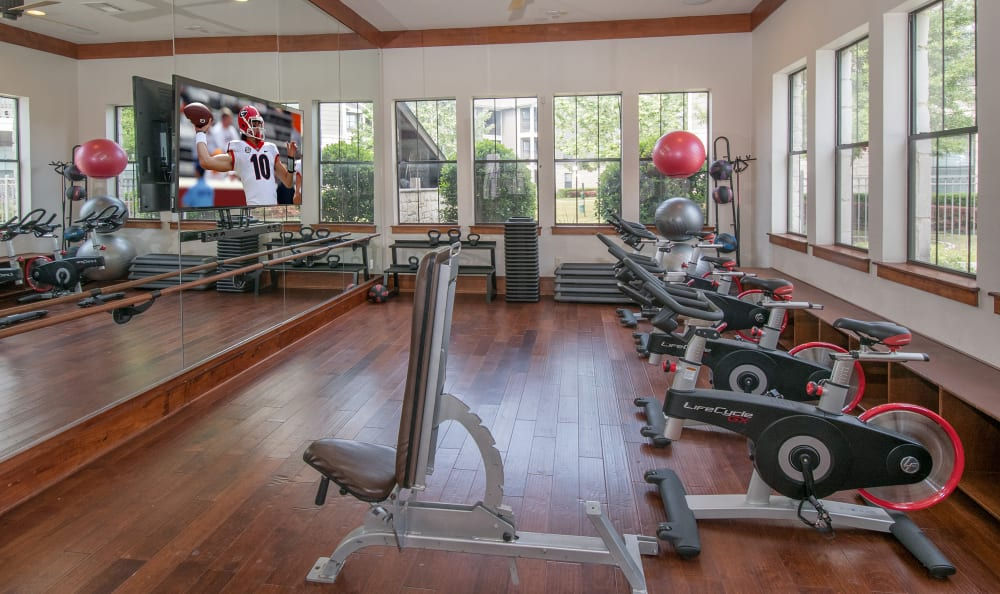 Fitness center with individual workout stations at Villas Tech Ridge in Pflugerville, Texas