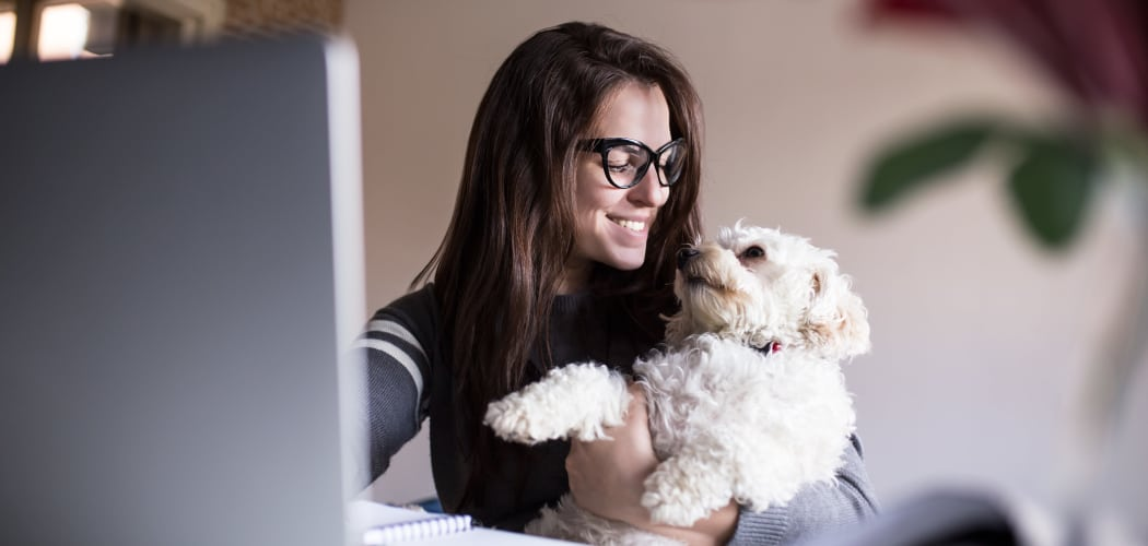 Resident and her dog enjoying their new home at Cantare at Indian Lake Village in Hendersonville, TN