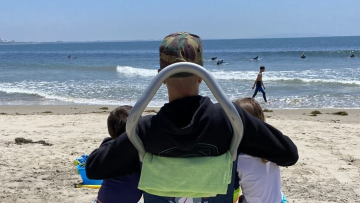 Jesse Billauer on the beach with his kids