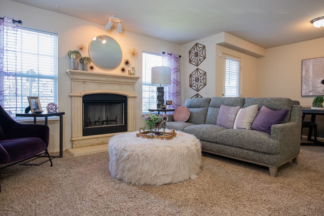 Bright and cheerful living room and dining room at Coffee Creek Apartments in Owasso, Oklahoma