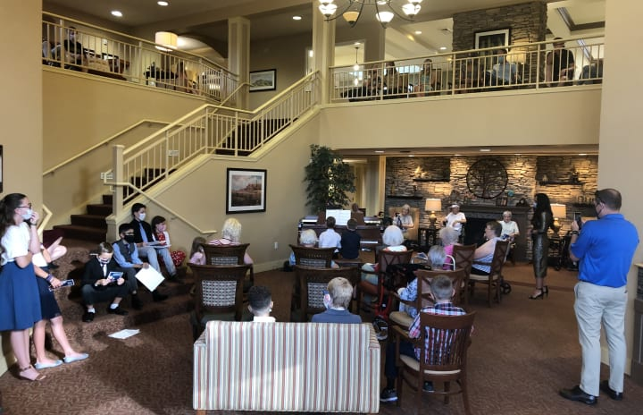 The Oaks hosted a local piano recital as residents gathered around to hear the wonderful music.
