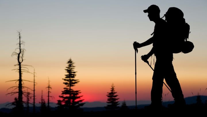 Silhouette of a person hiking