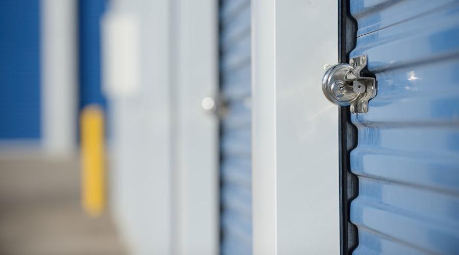 Storage units with blue doors and locks at KO Storage of Azle in Azle, Texas