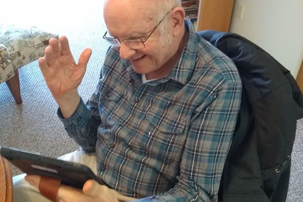 senior resident using a tablet