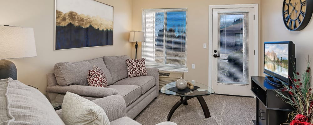 Inviting living room in a senior apartment at The Springs at Grand Park in Billings, Montana