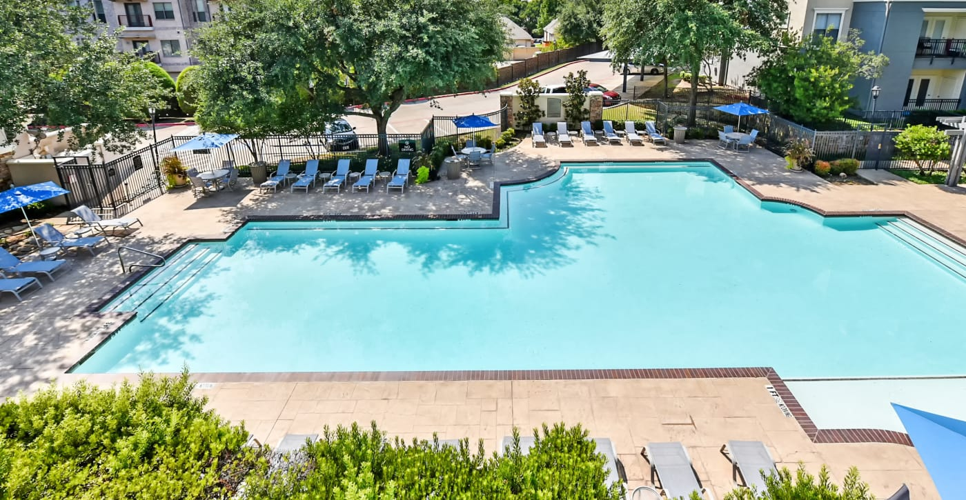 Gorgeous swimming pool area at Abbey at Vista Ridge Apartments in Lewisville