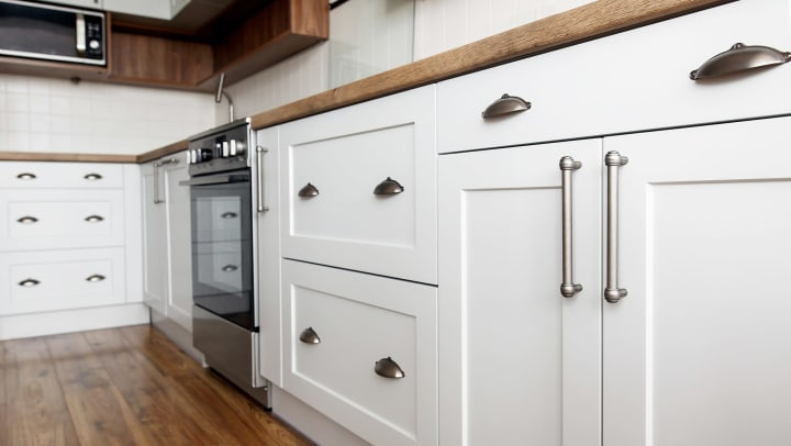Beautiful white cabinets in a kitchen at Lux on Main