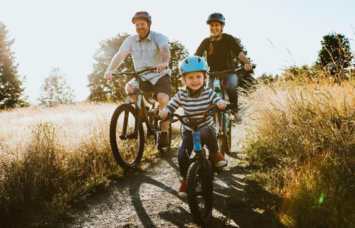 Family riding bikes near Trillium Apartments in Edmonds, Washington