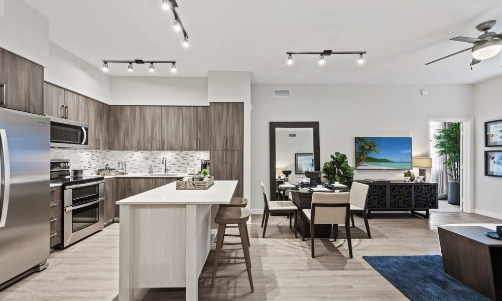 Kitchen and living area decorated with a light tone at 6600 Main in Miami Lakes, Florida