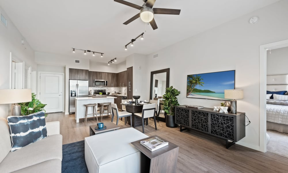 Light modern style kitchen and dining area with a breakfast bar at 6600 Main in Miami Lakes, Florida
