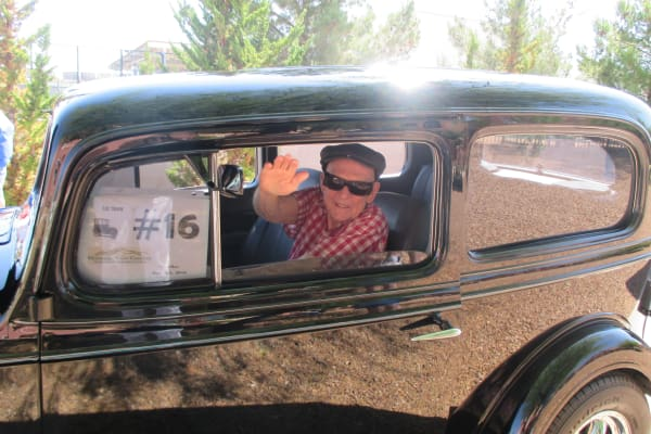 A resident from El Dorado Estates Gracious Retirement Living in El Dorado Hills, California in a classic car