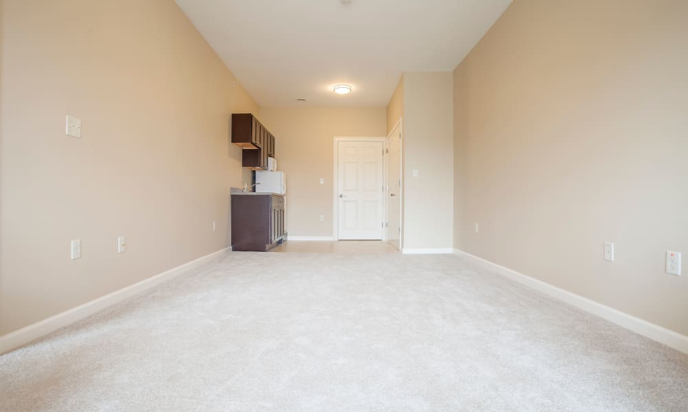 An empty apartment living room and kitchen at Keystone Place at  Buzzards Bay in Buzzards Bay, Massachusetts