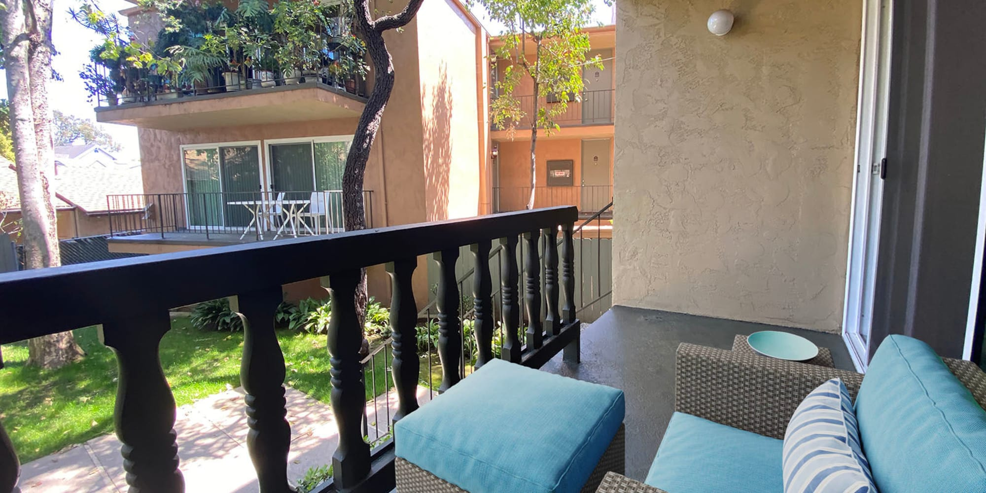 Private balcony with a terrific view of the garden-style community at Casa Granada in Los Angeles, California