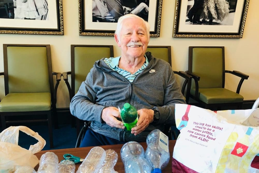 A resident making a bottle art project at CERTUS Premier Memory Care Living in Orange City, Florida.