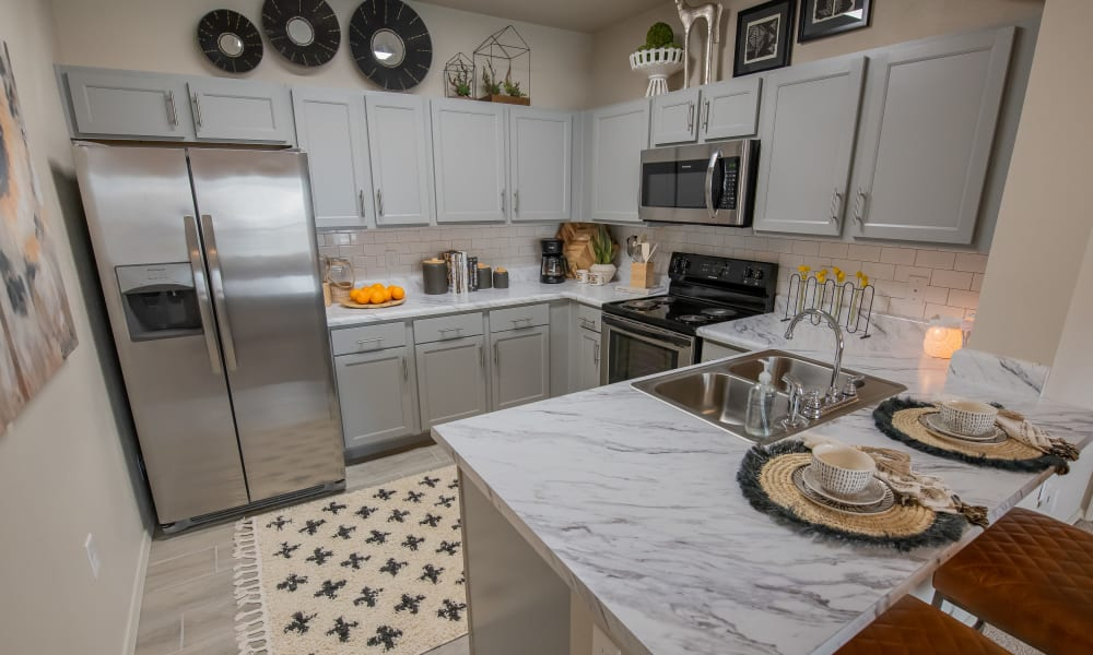 Fully-equipped kitchen at Bend at New Road Apartments in Waco, Texas