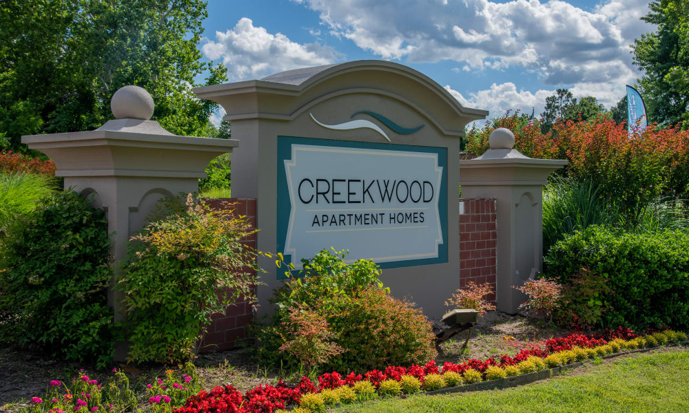 Welcome signage to Creekwood Apartments in Tulsa, Oklahoma