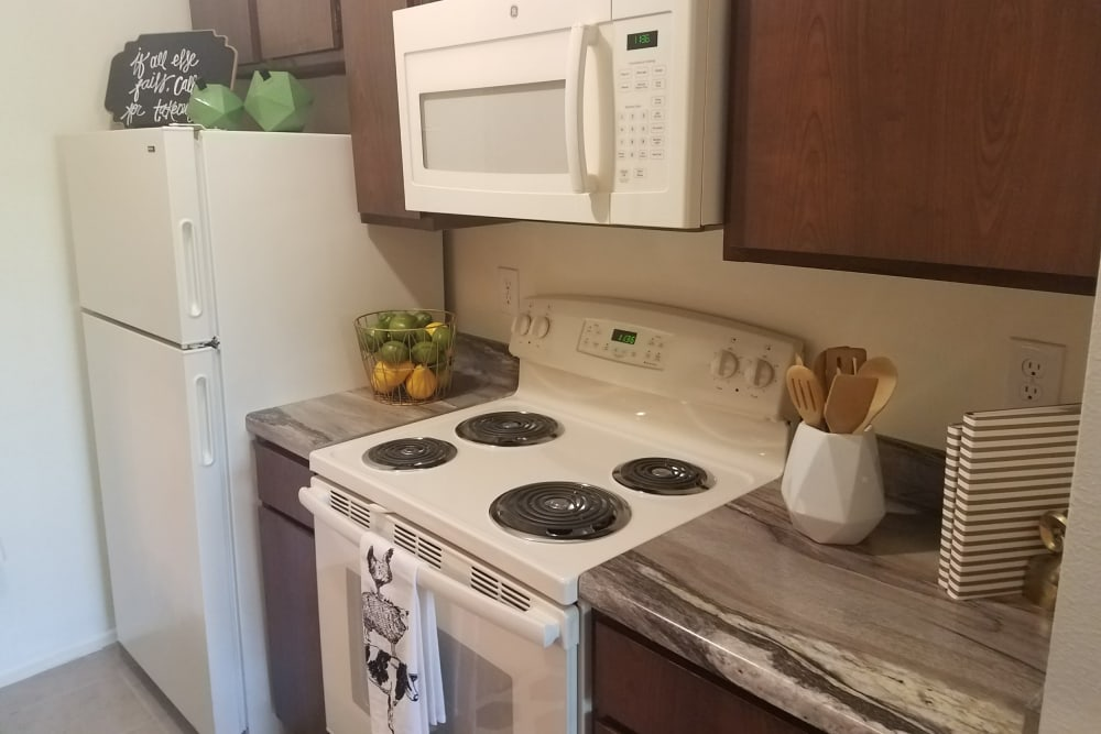 White kitchen appliances at The Chimneys Apartments in El Paso, Texas