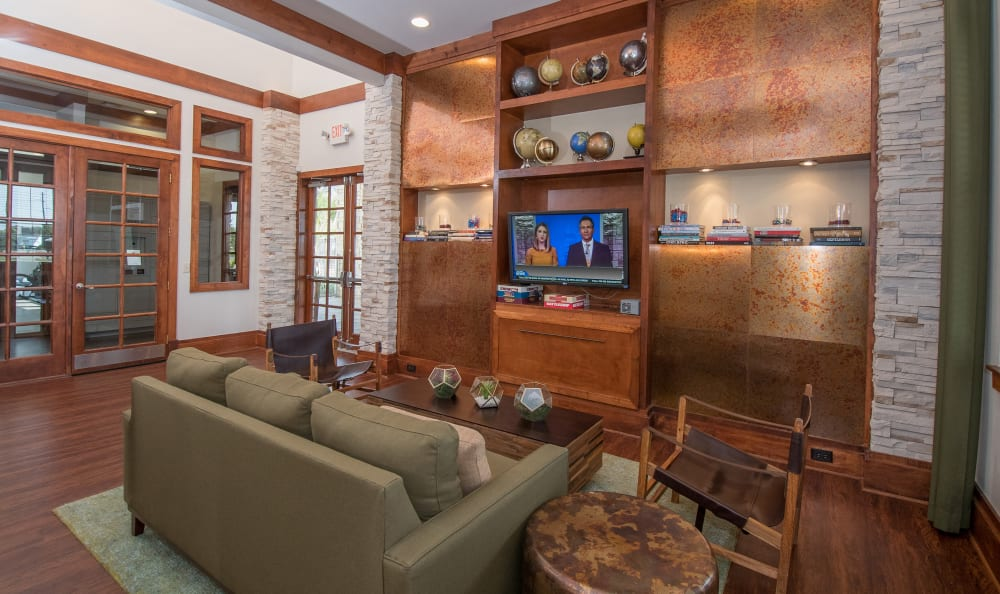 Spacious clubhouse with television and comfortable seating at Villas Tech Ridge in Pflugerville, Texas