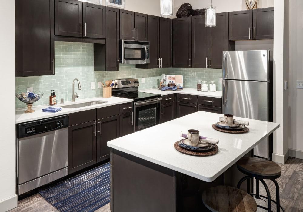 Enjoy a modern kitchen with breakfast bar at Axis 3700 in Plano, Texas