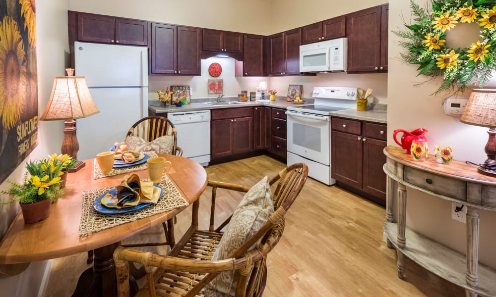 An apartment kitchen and dining room at Keystone Place at Forevergreen's fireplace in North Liberty, Iowa