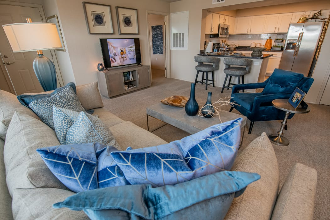 Cozy living room with open kitchen at Cottages at Crestview in Wichita, Kansas