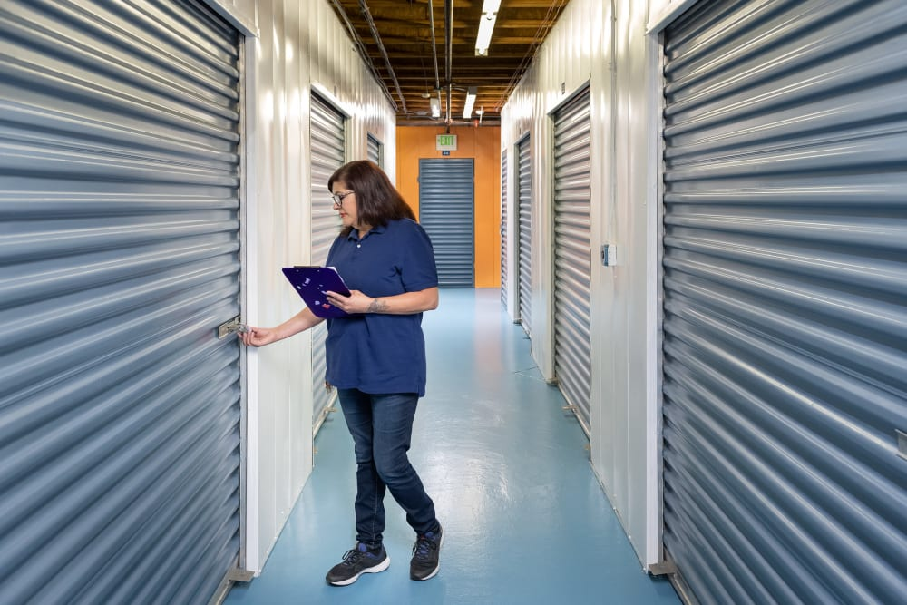 Employee checking the locks at Castro Valley Storage LLC in Castro Valley, California