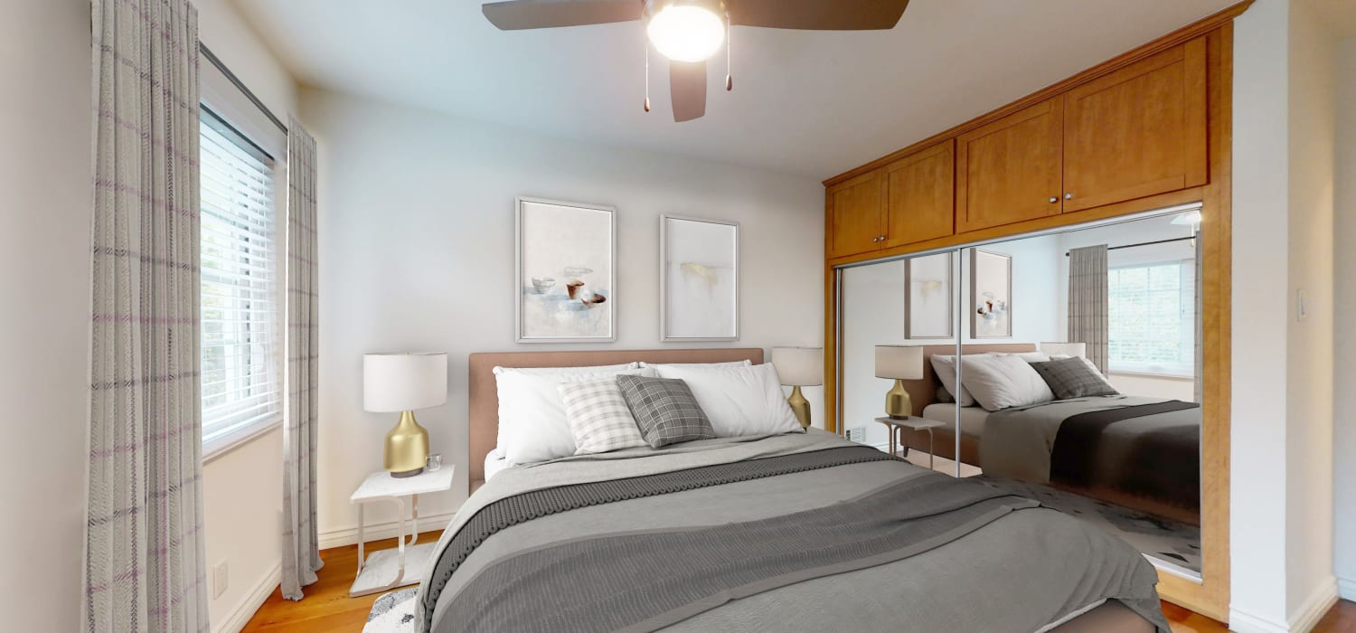 Ceiling fan and hardwood flooring in the primary suite of a model bungalow-style apartment at Sunset Barrington Gardens in Los Angeles, California