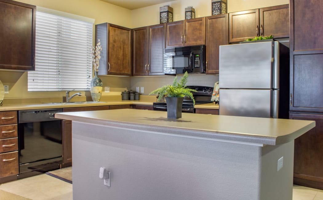 Modern kitchen with built-in island in model home at The Residences at Stadium in Surprise, Arizona