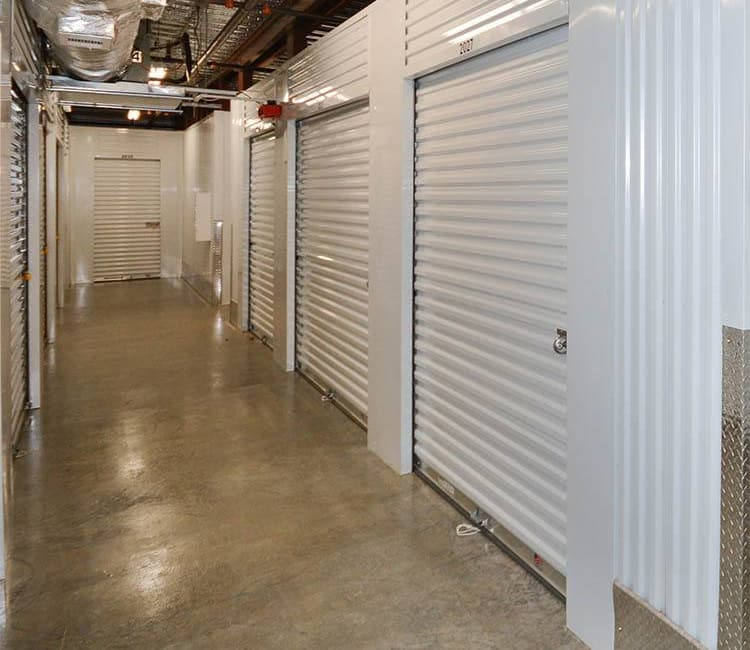 Well-lit indoor units at Space Shop Self Storage in Covington
