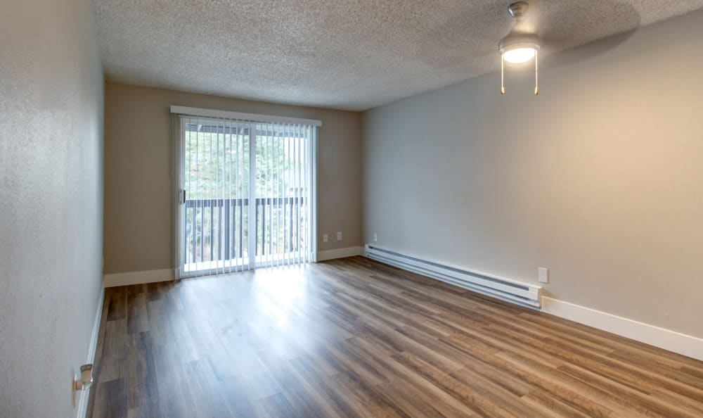 Ceiling fan and hardwood floors in apartment home at The Boulevard at South Station Apartment Homes in Tukwila, Washington