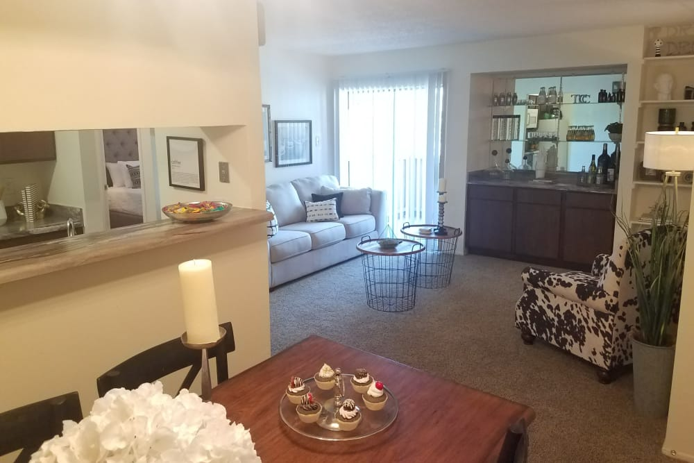 Dining and living area at The Chimneys Apartments in El Paso, Texas