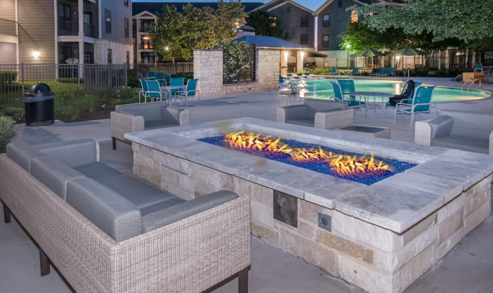 Poolside patio with fire pit at Villas Tech Ridge in Pflugerville, Texas