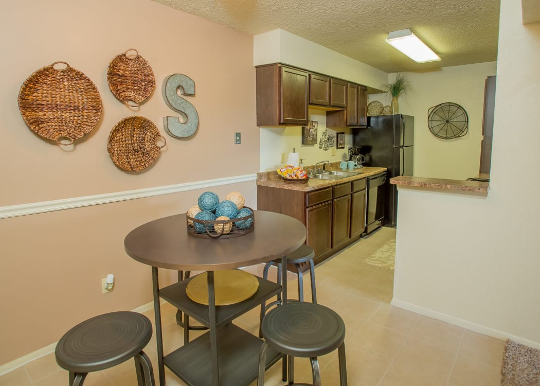 View of modern kitchen from dining area of model home at Sugarberry Apartments in Tulsa, Oklahoma