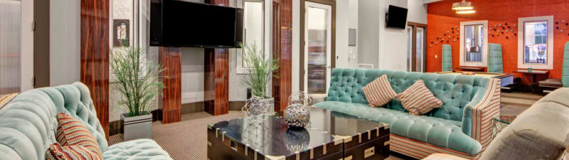 A television lounge at City Center on 7th Apartment Homes in Pembroke Pines, Florida