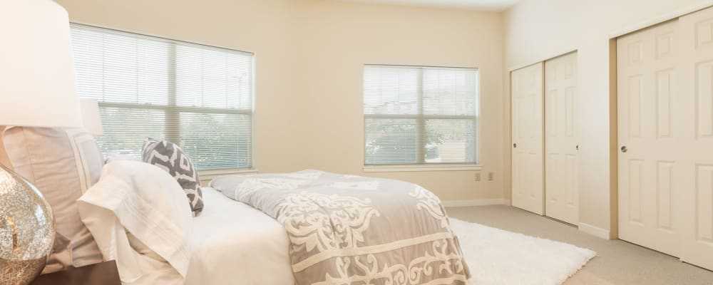 Large bedroom with windows in senior living apartment at The Springs at Tanasbourne in Hillsboro, Oregon
