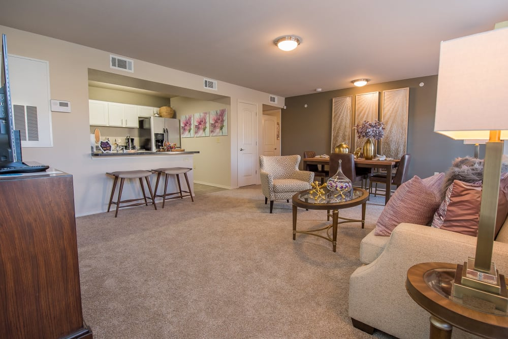 Spacious living room at Portico at Friars Creek Apartments in Temple, Texas