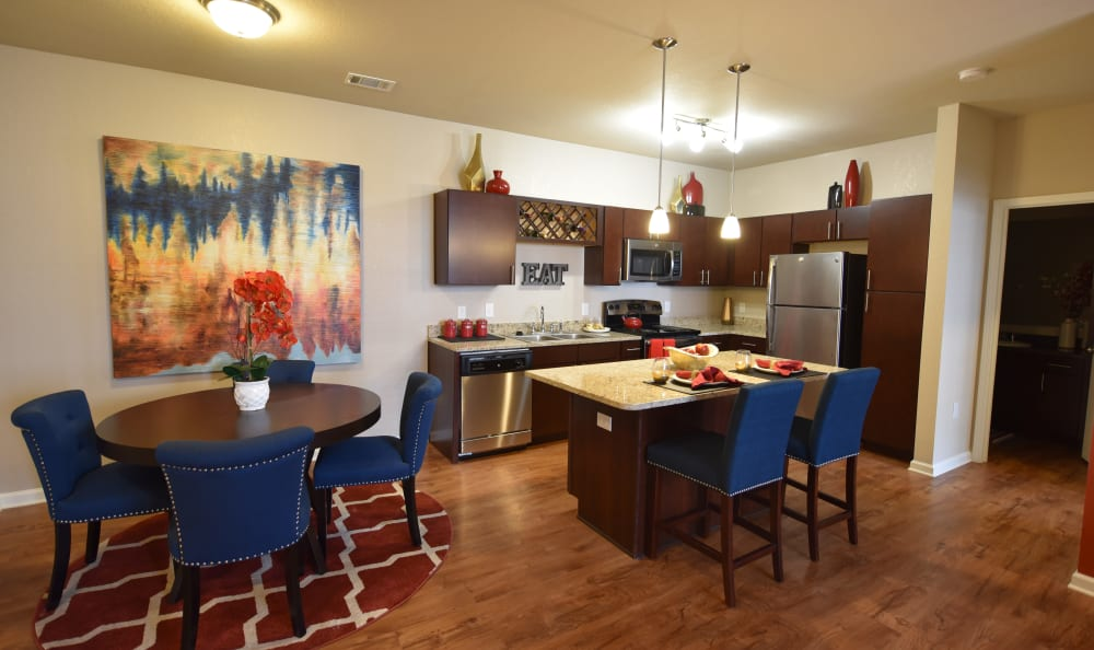 Dining room and kitchen at Springs at Liberty Township Apartments in Liberty Township