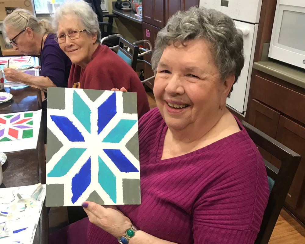 Resident creating art at Edencrest at Green Meadows in Johnston, Iowa.